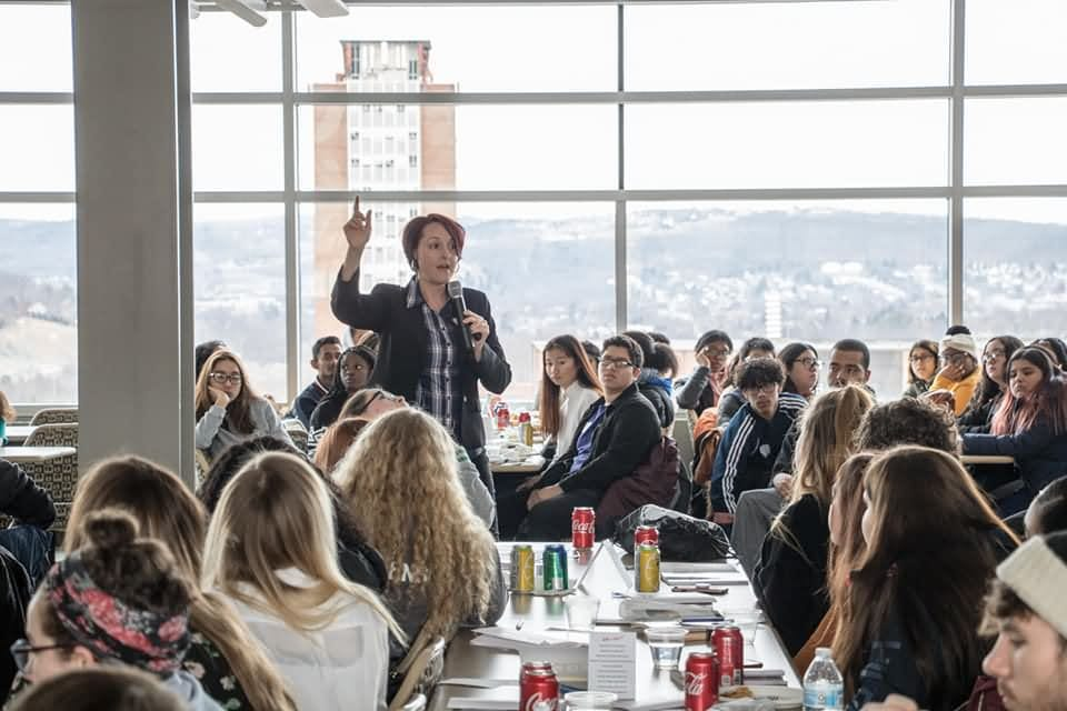 Jessica speaking to a large group of young people